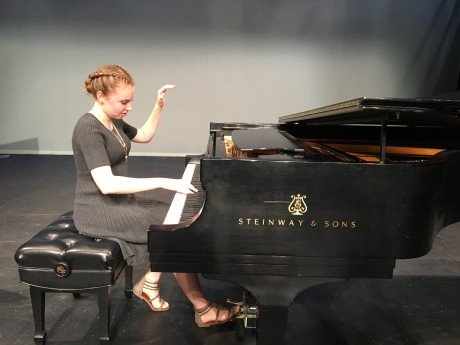 BISFA student Holly Stover performing on a Steinway piano at IIMIF